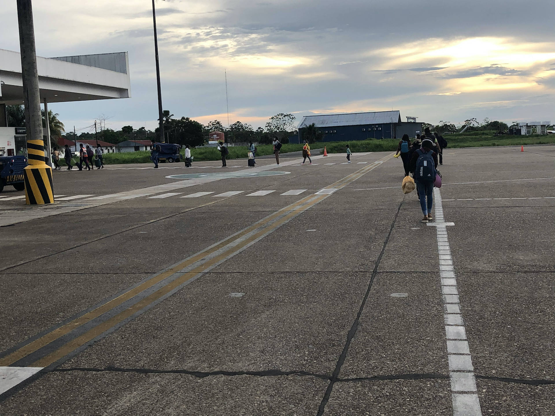 4. Oddly, you must walk single file after existing the airplane, keeping distance, of course. Officals nearby enforce the single file formation